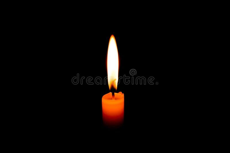 Romantisk bränningstearinljus i svart bakgrund royaltyfria bilder