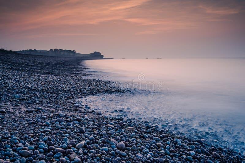 Romantyczny wschód słońca na plaży w Budleigh Salterton zdjęcia royalty free