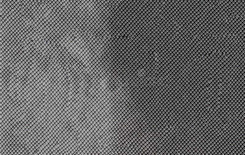 Rombos blancos de la fantasía en un fondo negro imagenes de archivo