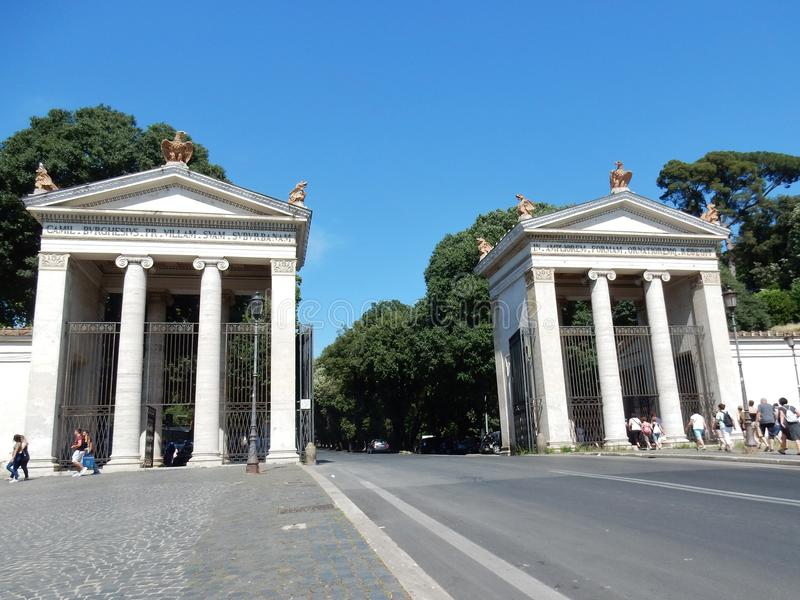 Rome - Access to Villa Borghese. Rome, Lazio, Italy - May 30, 2017: the monumental entrance of Villa Borghese seen from Piazzale Flaminio stock images