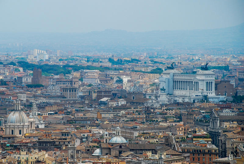 Rome aerial view. Aerial view of the buildings and streets from the roof point of The Papal Basilica of St. Peter in Vatican city, Italy royalty free stock photography