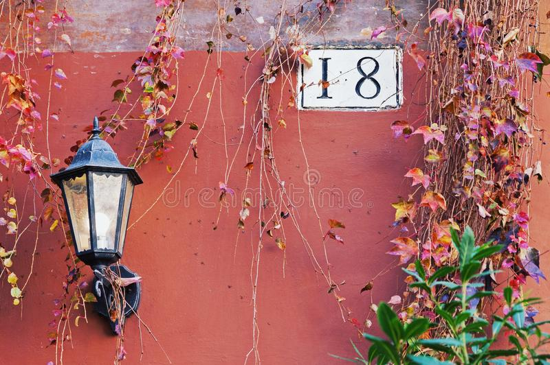 Rome architecture detail with street lamp and house number stock images