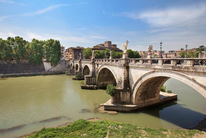 Rome: Banks of the Tiber. Bernini's white marble angels on the Ponte Sant'Angelo on the brigde across of the River Tiber stock image