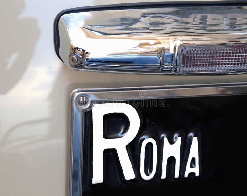 ROME big writing on the italian car. ROME big writing on the old italian car stock photos