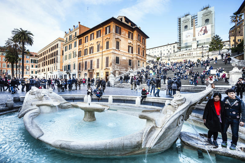 Rome center monuments. Old boat fountain and tourists, Spanish steps. Italy royalty free stock photos