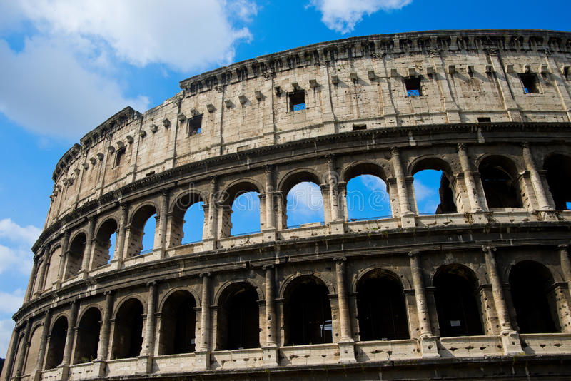 Rome - Colosseum and sky. The Flavian Amphitheatre with his arch was the largest amphitheatre of the Roman Empire. Image of 7000px royalty free stock image