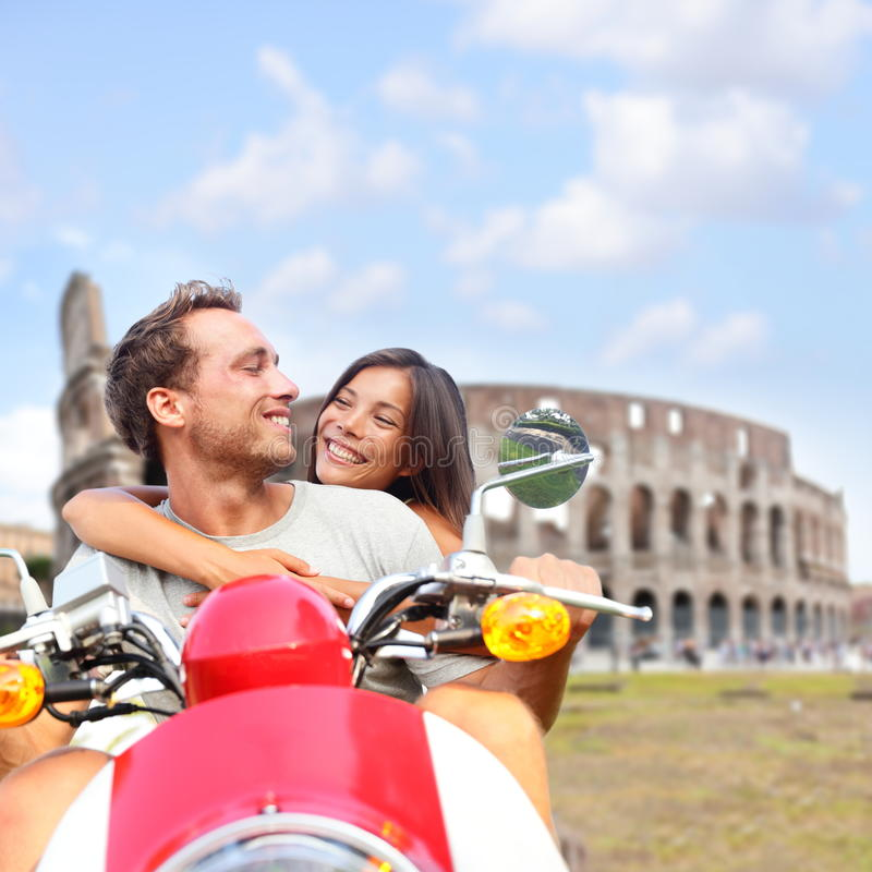 Rome couple on scooter by Colosseum, Italy royalty free stock images