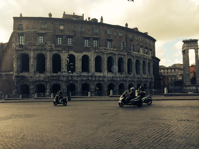 Scooter in front of Colosseum in Rome royalty free stock photo