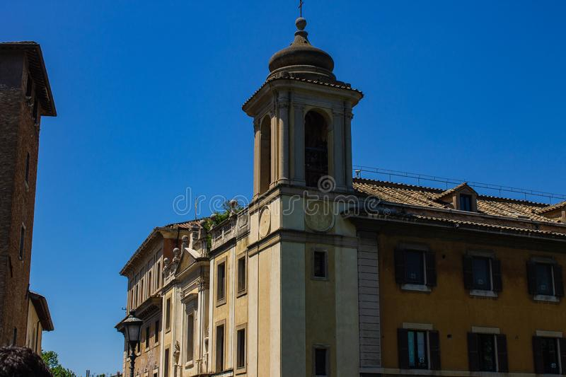 The bell tower of a church. The arches that enclose the bells are visible. royalty free stock images