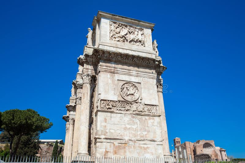 Arch of Constantine a triumphal arch in Rome, situated between the Colosseum and the Palatine Hill. The Arch of Constantine a triumphal arch in Rome, situated royalty free stock photos