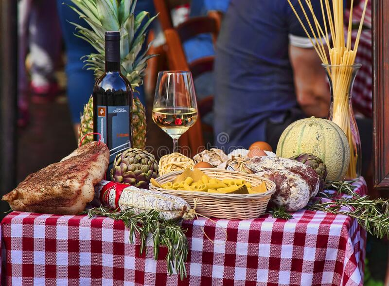 Rome, Italy - April 11, 2018: Mediterranean and italian food with pasta, cheese, sausages, herbs and wine royalty free stock photo