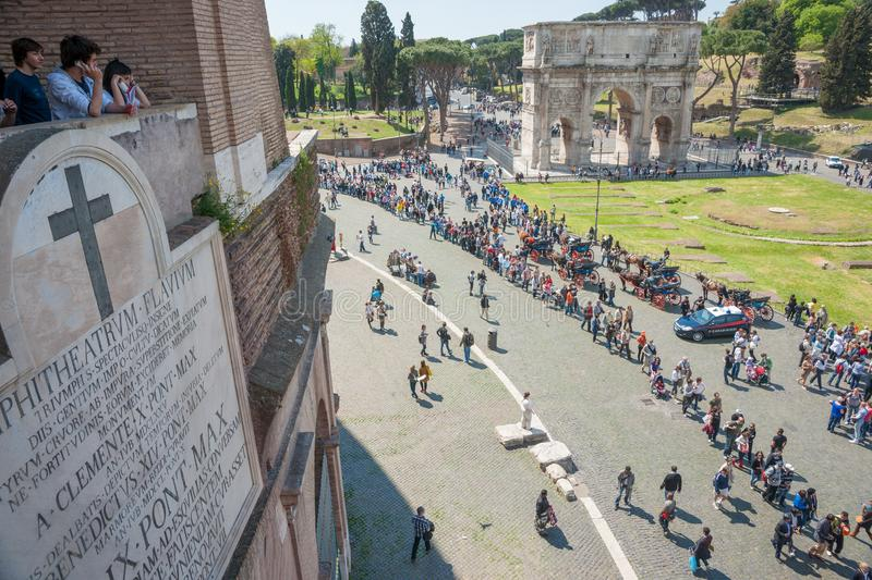 Rows of tourists line up outside the colesseum waiting for entr stock photo
