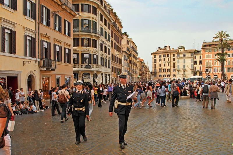 Rome, Italy - APRIl 7, 2017 : Two police officers walking along royalty free stock photography