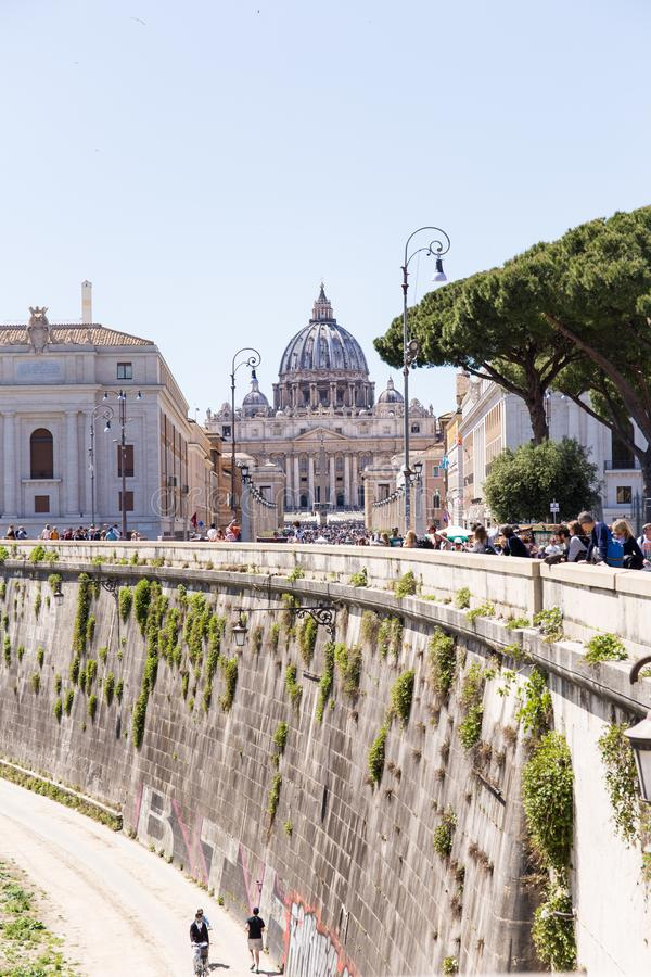 ROME, ITALY - APRIL 27, 2019: View from the distance of Saint Peter`s Basilica from Tiber edge. stock photography