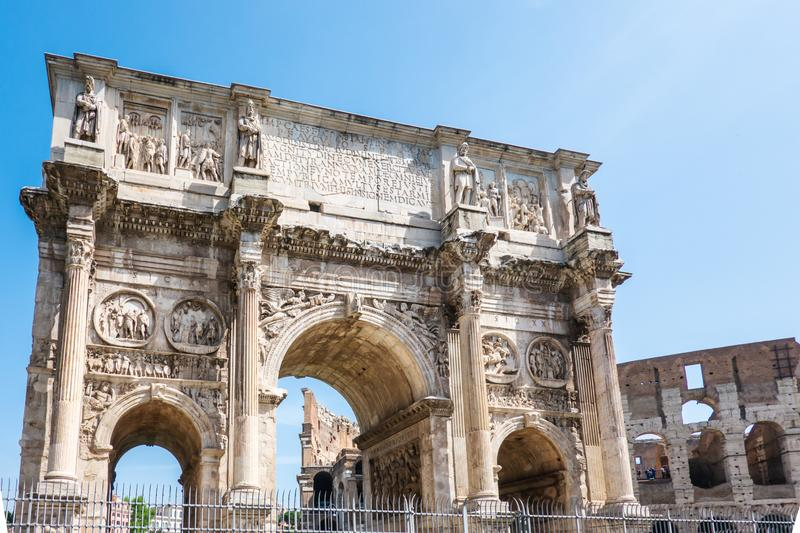 ROME, Italy: The Arch of Constantine in Rome with Colosseum in background. Arco di Costantino.  royalty free stock photos