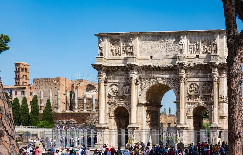 ROME, Italy: The Arch of Constantine in Rome with the Venus Temple in background. Arco di Costantino e Tempio di Venere. Tourists royalty free stock images