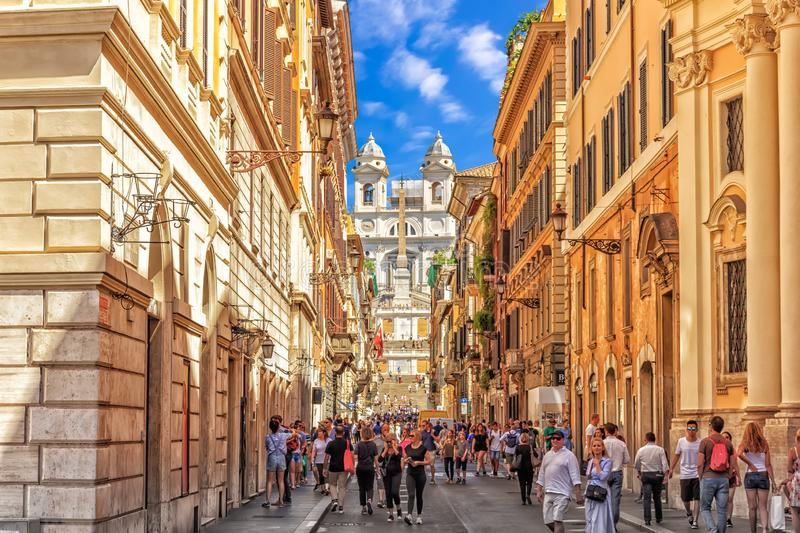 Italian street Via dei Condotti, leading to Piazza di Spagna and the Spanish Steps on a sunny day. Rome/Italy - 26 August, 2018: Italian street Via dei Condotti royalty free stock photos