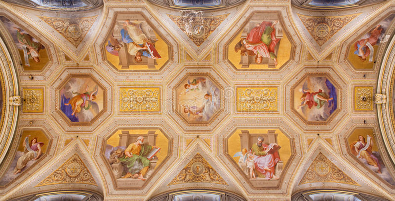 ROME, ITALY: Ceiling fresco with the Four Evangelist in church Chiesa di Santa Maria in Aquiro by Cesare Marianni. ROME, ITALY - MARCH 9, 2016: The ceiling royalty free stock photo