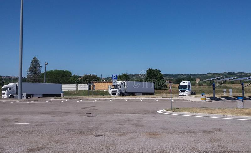 White lorry trucks. ROME, ITALY - CIRCA JULY 2016: white lorry trucks parked in service area stock photos