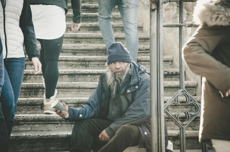 Rome, Italy - Dec 25, 2017 - Old homeless man sitting on the sta stock images