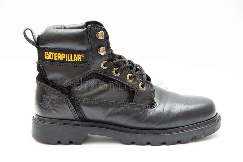 Caterpillar boot in black leather royalty free stock photo