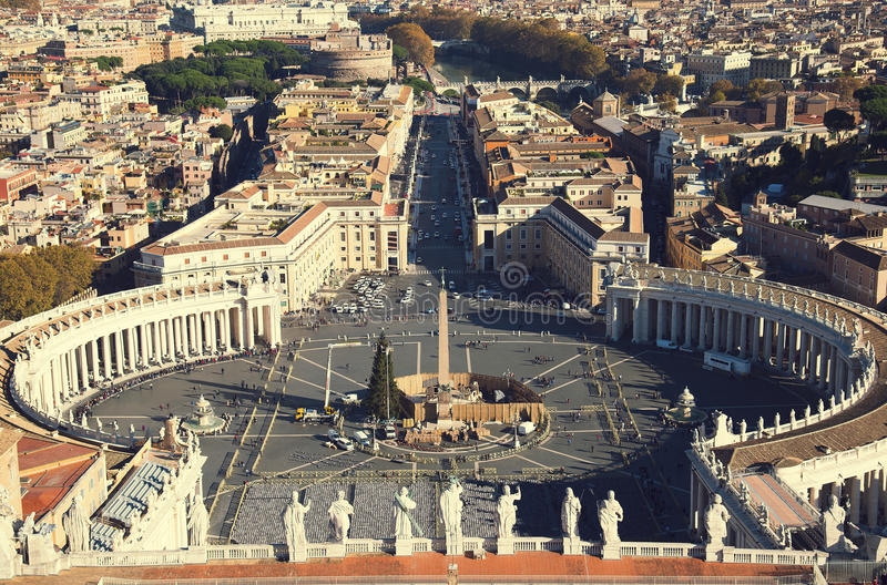 Rome, Italy. Famous Saint Peter`s Square in Vatican and aerial view of the city mission. royalty free stock images