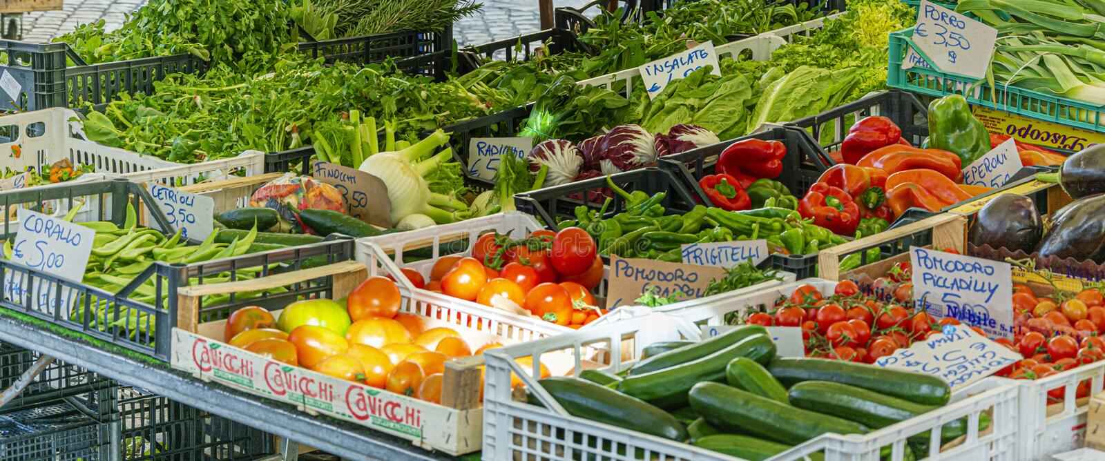 Mixed vegetables, including tomatoes, peppers and courgettes, on sale in a stand in the historic Campo de Fiori street market in. Rome, Italy, February 2017 royalty free stock image