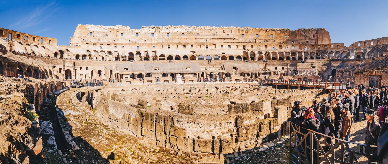Rome, Italy, February 2018: Tourists anjoying the panorama inside Colosseum, Rome, Italy stock photography