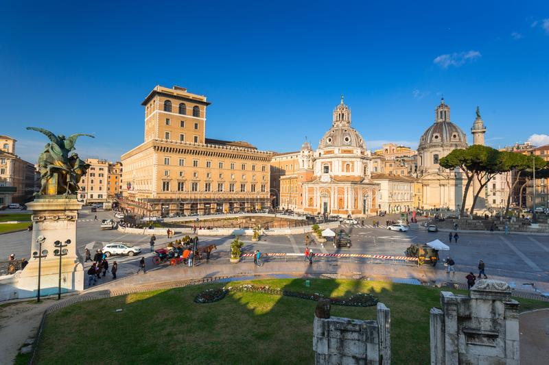 Rome, Italy - January 9, 2019: People at the Trajan Market in Rome at sunny day, Italy. Column, monument, white, forum, triumphal, italian, ruins, piazza royalty free stock photos