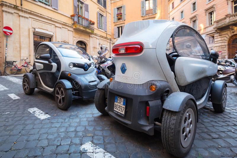 Rome , Italy - January 9, 2019: Small electric cars Renault Twizy parked on the street of the old town in Rome. Energy, technology, transport, green, power stock photo