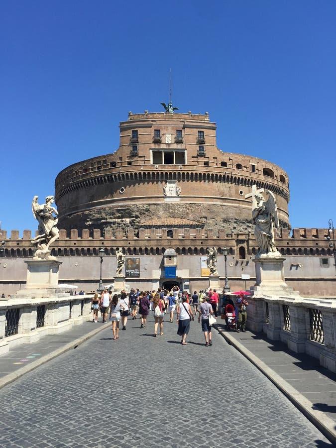 Tourists at Saint Angel Bridge and Saint Angel Castle, Rome, Italy. stock photos