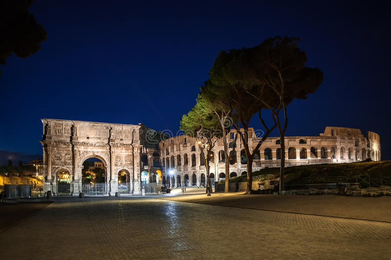 ROME, ITALY - JUNE 6, 2016: Night view of The Arch of Constantine (Arco de Constantino) and Coliseum royalty free stock photo