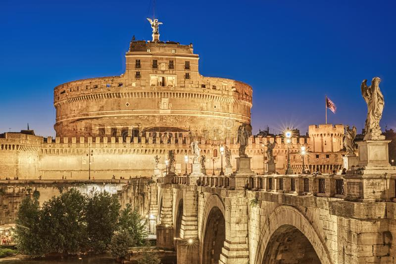 Night view of the Castel Sant'Angelo fortress, in the center of Rome, Italy stock photography