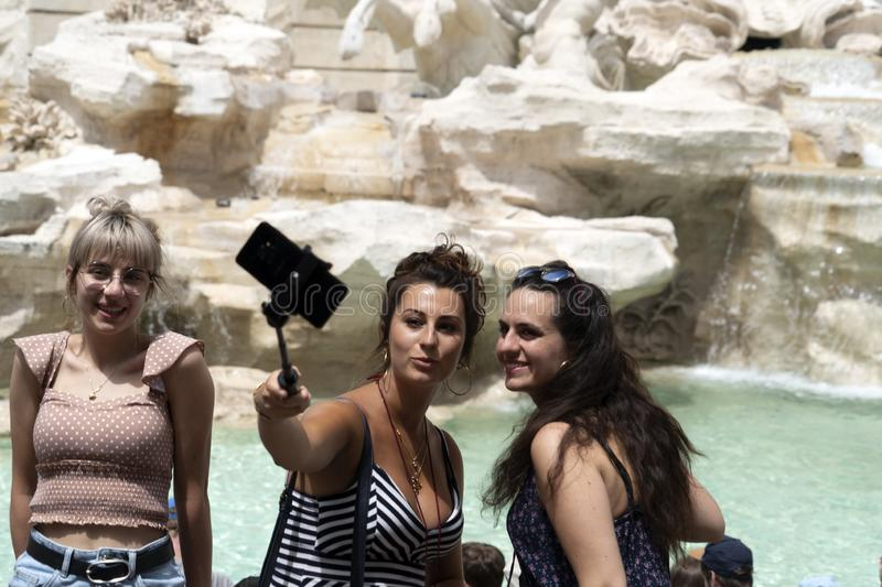 ROME, ITALY - JUNE 15 2019 - Tourist taking selfie at Fontana di Trevi fountain. On sunny day royalty free stock photos