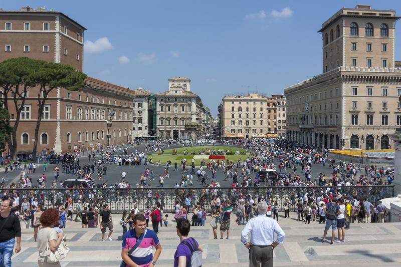 Rome, Italy - June 2, 2012 tourists flocking to Piazza del Vittoriano and Piazza Venezia in the background royalty free stock images