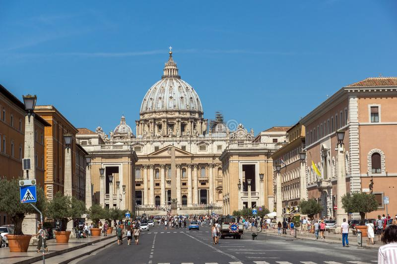 Tourists visit Saint Peter`s Square and St. Peter`s Basilica in Rome, Vatican, Italy. ROME, ITALY - JUNE 23, 2017: Tourists visit Saint Peter`s Square and St stock photo