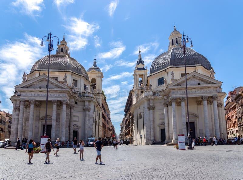Twin churches of Santa Maria on Piazza del Popolo - Rome, Italy. Rome, Italy - June 13 2019: Twin churches of Santa Maria dei Miracoli and Santa Maria in stock photos