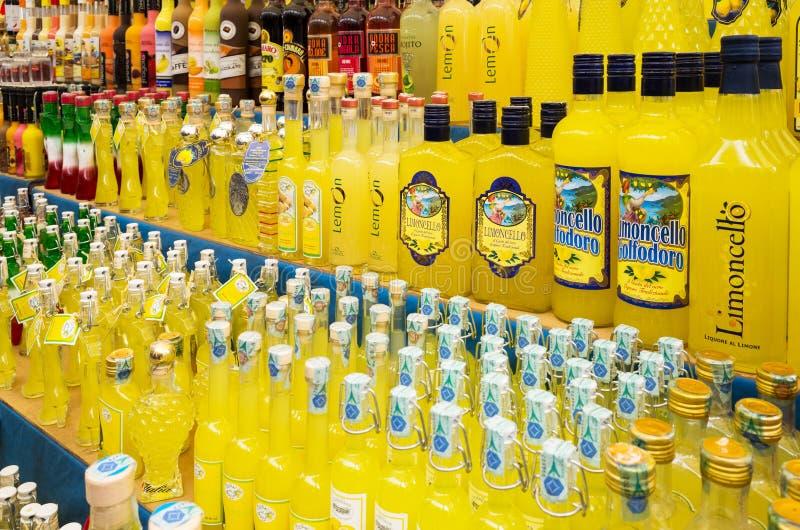Various alcoholic beverages sold on the market. Popular Italian lemon liqueur Limoncello royalty free stock photo
