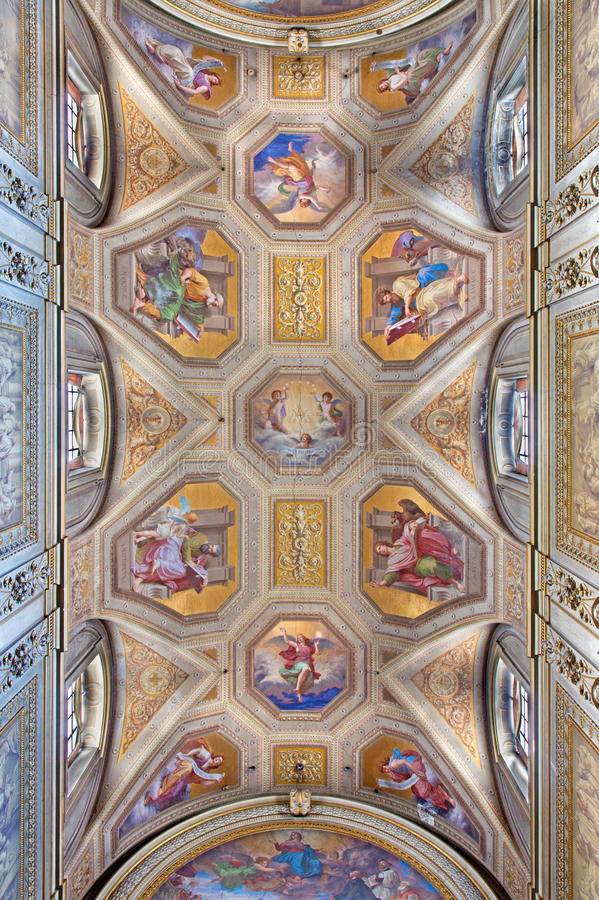 ROME, ITALY - MARCH 9, 2016: The ceiling fresco with the Four Evangelist in church Chiesa di Santa Maria in Aquiro. By Cesare Mariani from (1826 - 1901 in neo royalty free stock image