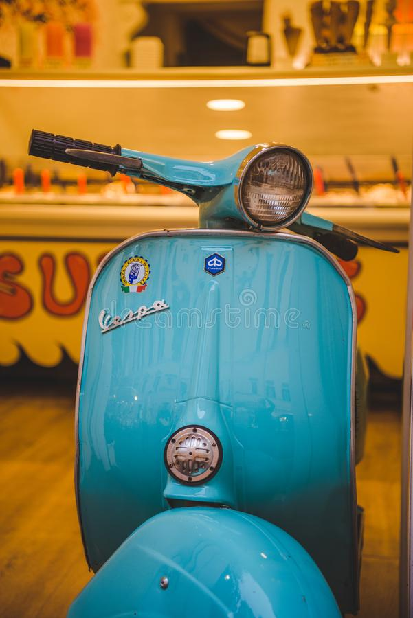 close-up shot of vintage vespa scooter parked on street of Rome stock image