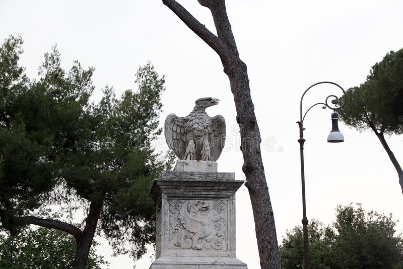 Rome, Italy - May 29, 2018: eagle statue in Villa Borghese Park. Decorations and monuments of Borghese Park in Rome, Italy royalty free stock photography