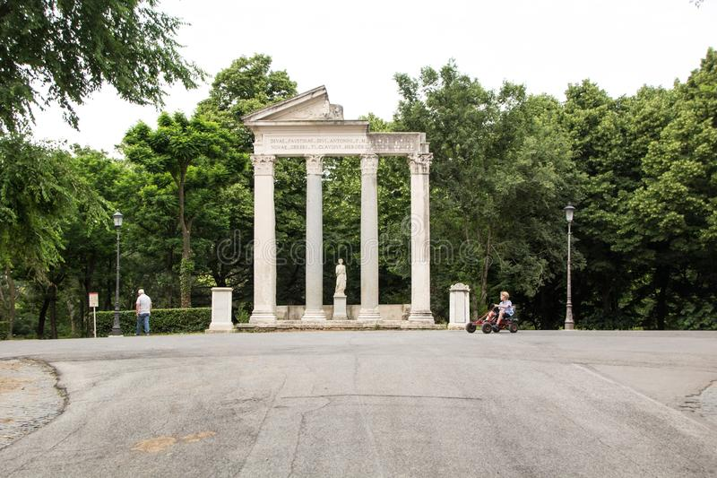 Rome, Italy - May 29, 2018: Historical Roman columns inside the Villa Borghese Park. Walking route of the Villa Borghese Gardens royalty free stock photo