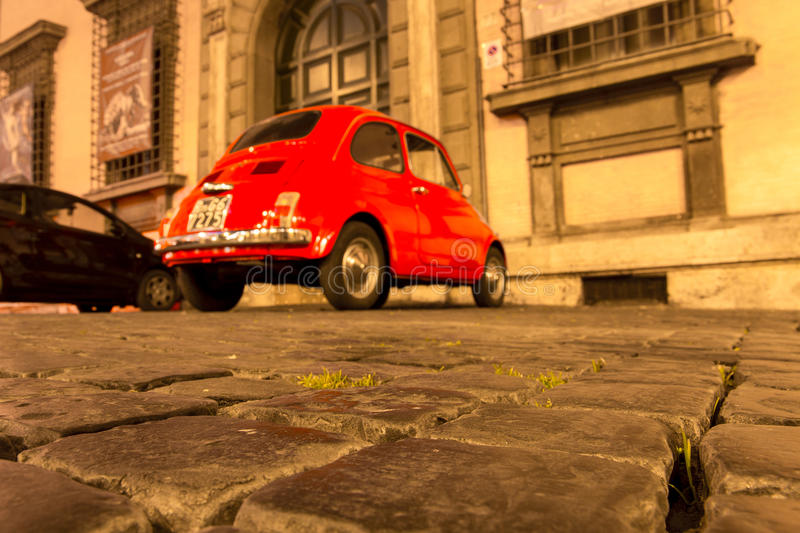 ROME, ITALY - MAY 10, 2016: Old streets of Rome with Fiat 500. Parked on cobbled stones royalty free stock photo