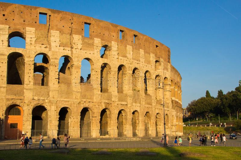 Rome, Italy - May 31, 2018: Roman Colosseum at sunset. Tourists walk near the Colosseum, Golden evening hour. Not restored old royalty free stock photos
