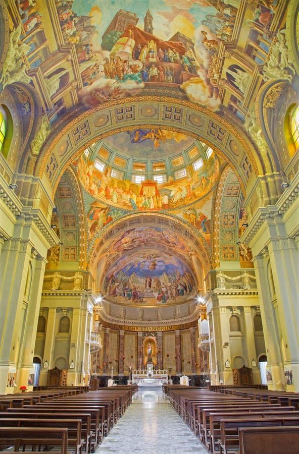 ROME, ITALY: The nave of church Basilica di Santa Maria Ausiliatrice with the frescoes. ROME, ITALY - MARCH 10, 2016: The nave of church Basilica di Santa Maria stock image