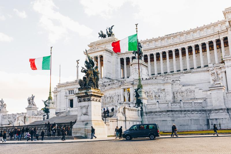 ROME, ITALY - NOVEMBER 30, 2017: Memorial monument the Vittoriano or Altar of the Fatherland, in Venezia square, with waving ital stock photos