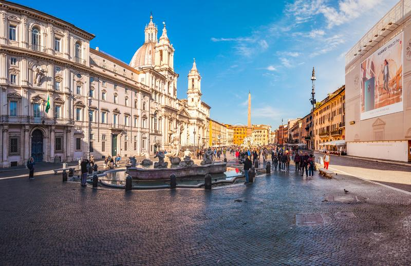Panorama of Piazza Navona square full of famous fountains, attractions and people in Rome, Italy. It is built on the site of the stock photography