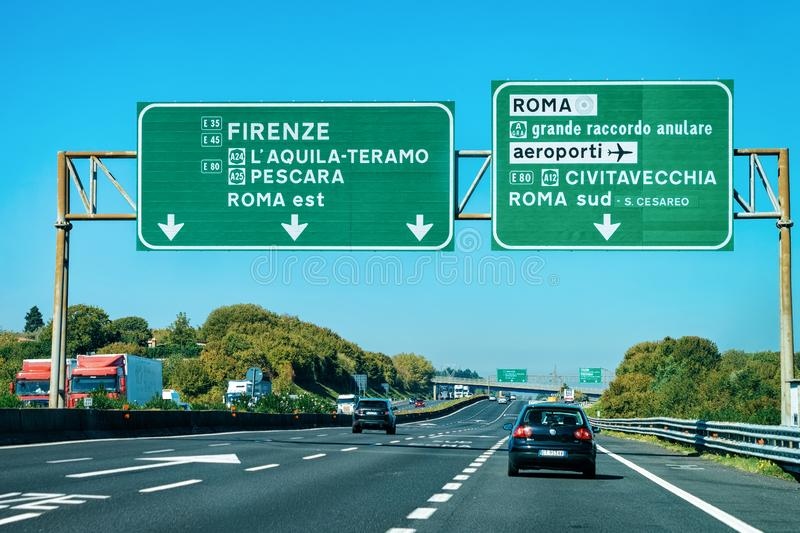 Cars and green traffic signs to Firenze and Roma in the road in Italy. Rome, Italy - October 4, 2017: Cars and green traffic signs to Firenze and Roma in the stock images