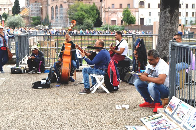 Rome, Italy - October 7, 2018: Street musicians are happy to entertain tourists in the historical part of the city near the Roman royalty free stock image