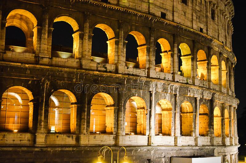 Rome, Italy. One of the most popular place in world at evening - illuminated Roman Coliseum under dark sky.  royalty free stock photos